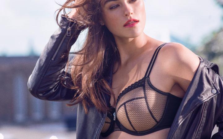 Model in motorcycle jacket and black bra