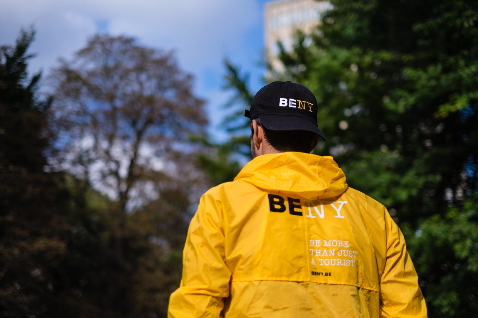 Man with a BENY cap and raincoat
