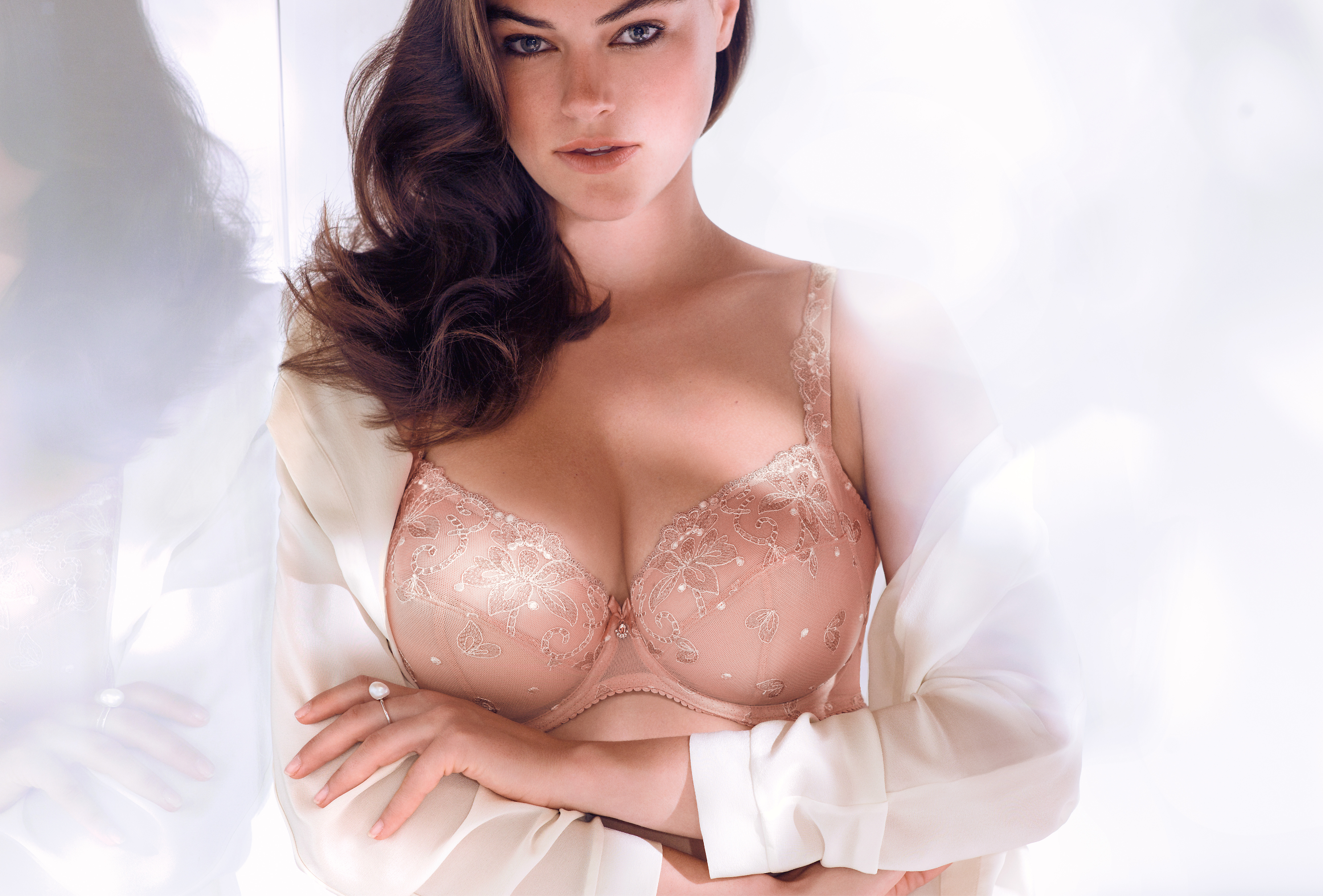 Model in white cloth and a pink bra